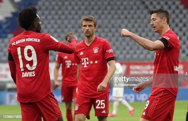 Alphonso Davies of Bayern Munich celebrates with Robert Lewandowski of Bayern Munich after he scores his teams fourth goal during the Bundesliga...