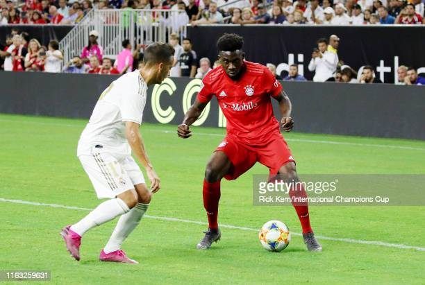 Alphonso Davies of Bayern Munich handles the ball against Real Madrid in the 2019 International Champions Cup at NRG Stadium on July 20 2019 in...