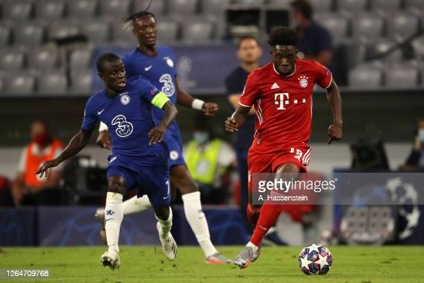 Alphonso Davies of Bayern Munich is challenged by N'Golo Kante of Chelsea during the UEFA Champions League round of 16 second leg match between FC...