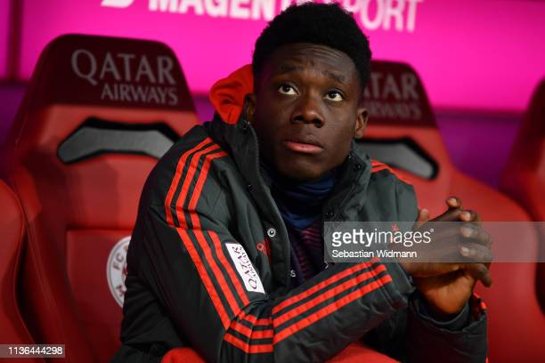 Alphonso Davies of Bayern Munich looks on prior to the Bundesliga match between FC Bayern Muenchen and 1 FSV Mainz 05 at Allianz Arena on March 17...