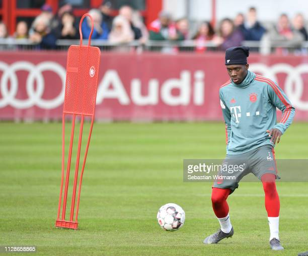 Alphonso Davies of Bayern Munich plays the ball during a FC Bayern Muenchen training session at Saebener Strasse training ground on February 10 2019...