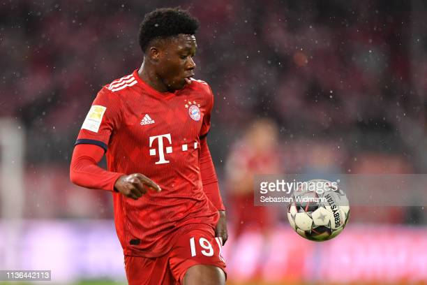 Alphonso Davies of Bayern Munich plays the ball during the Bundesliga match between FC Bayern Muenchen and 1 FSV Mainz 05 at Allianz Arena on March...