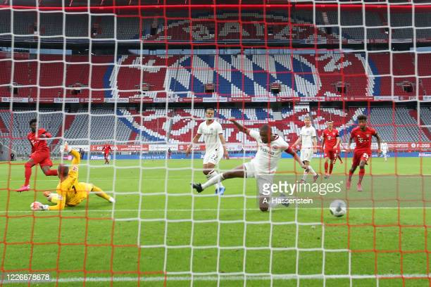Alphonso Davies of Bayern Munich scores his teams fourth goal during the Bundesliga match between FC Bayern Muenchen and Eintracht Frankfurt at...