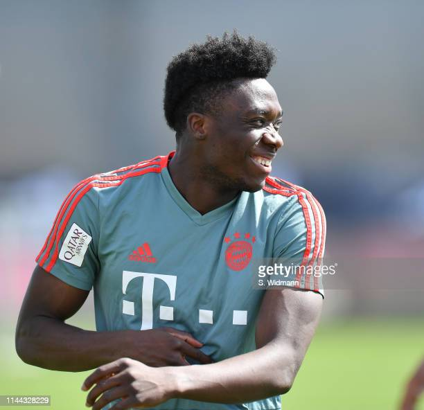 Alphonso Davies of Bayern Munich smiles during a FC Bayern Muenchen training session at Saebener Strasse training ground on April 22 2019 in Munich...