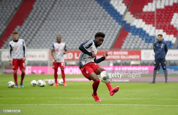 Alphonso Davies of Bayern Munich warms up ahead of the Bundesliga match between FC Bayern Muenchen and Eintracht Frankfurt at Allianz Arena on May 23...