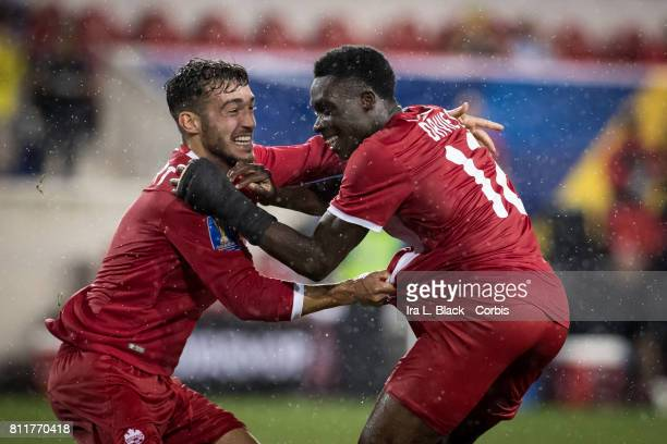 Alphonso Davies of Canada and Russell Teibert of Canada celebrate Davies 2nd goal of the match during the CONCACAF Gold Cup Match between Canada and...