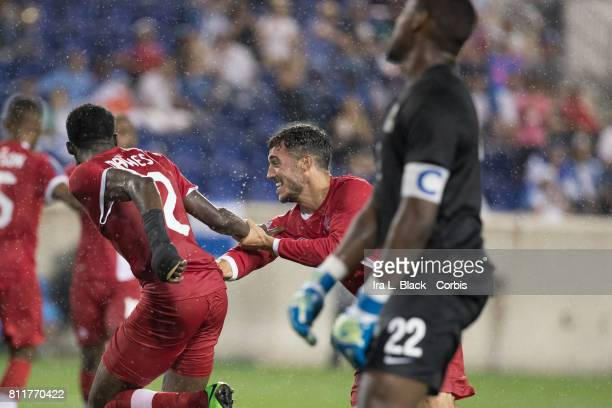 Alphonso Davies of Canada and Russell Teibert of Canada celebrate Davies 2nd goal of the match with Goalkeeper and Captain Donovan Leon of the French...