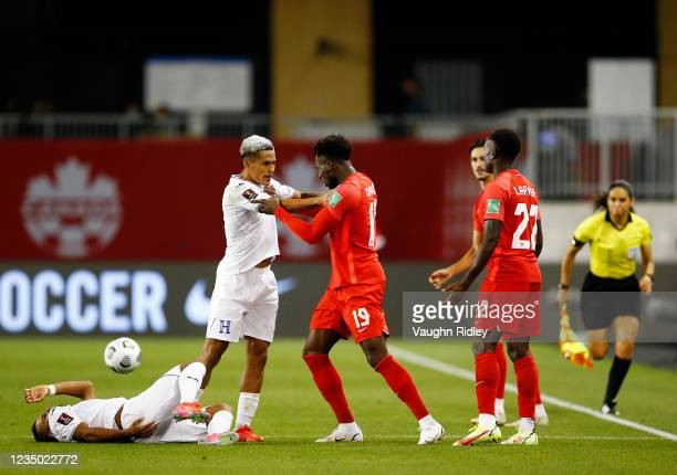 Alphonso Davies of Canada argues with Andy Najar of Honduras during a 2022 World Cup Qualifying match at BMO Field on September 2, 2021 in Toronto,...