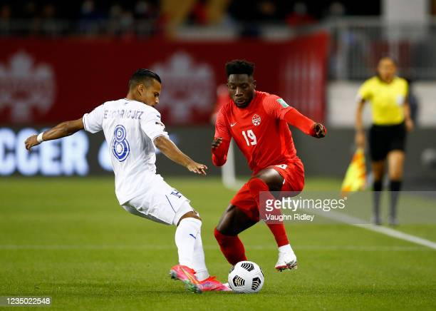 Alphonso Davies of Canada battles for the ball with Edwin Rodriguez of Honduras during a 2022 World Cup Qualifying match at BMO Field on September 2,...
