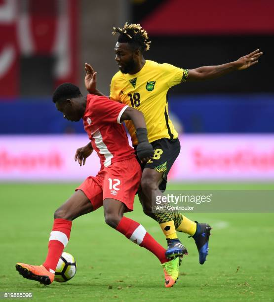 Alphonso Davies of Canada battles Owayne Gordon of Jamaica in the first half of their CONCACAF Gold Cup quarterfinal match July 20 2017 at the...