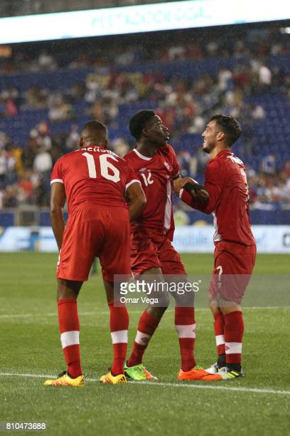 Alphonso Davies of Canada celebrates with teammates after scoring the fourth goal of his team during the Group A match between French Guiana and...