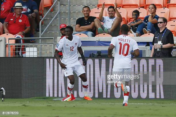 Alphonso Davies of Canada celebrates with this teammates after scoring against Canada in the first half at BBVA Compass Stadium on July 11 2017 in...