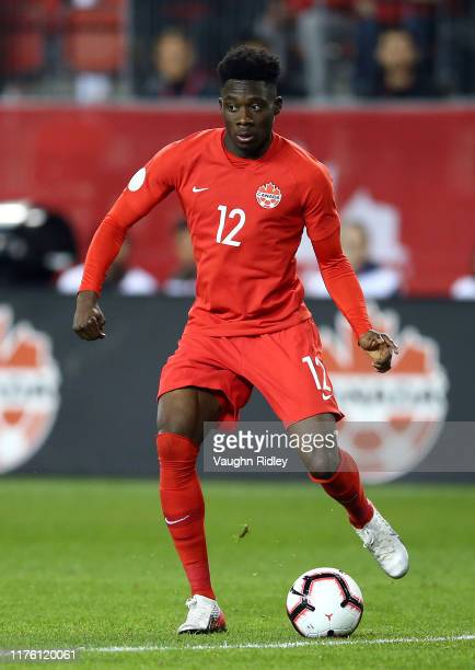 Alphonso Davies of Canada dribbles the ball during a CONCACAF Nations League game against the United States at BMO Field on October 15, 2019 in...