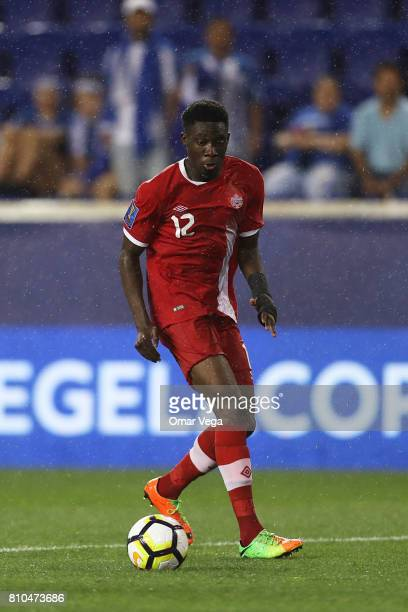 Alphonso Davies of Canada drives the ball during the Group A match between French Guiana and Canada as part of the Gold Cup 2017 at Red Bull Arena on...
