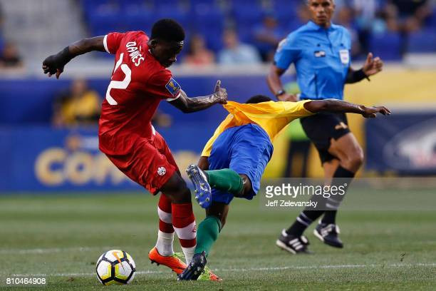 Alphonso Davies of Canada fights for the ball with Loic Baal of French Guiana during their Concacaf Gold Cup match at Red Bull Arena on July 7 2017...
