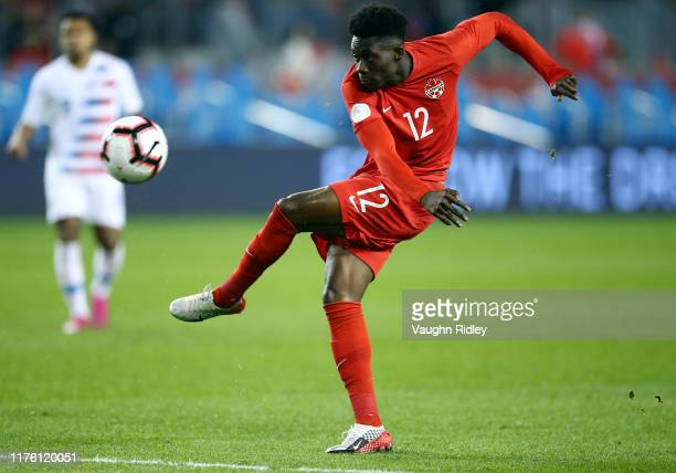 Alphonso Davies of Canada has a shot on goal during a CONCACAF Nations League game against the United States at BMO Field on October 15 2019 in...