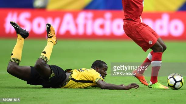Alphonso Davies of Canada leaps over JeVaughn Watson of Jamaica in the first half of their CONCACAF Gold Cup quarterfinal match July 20 2017 at the...