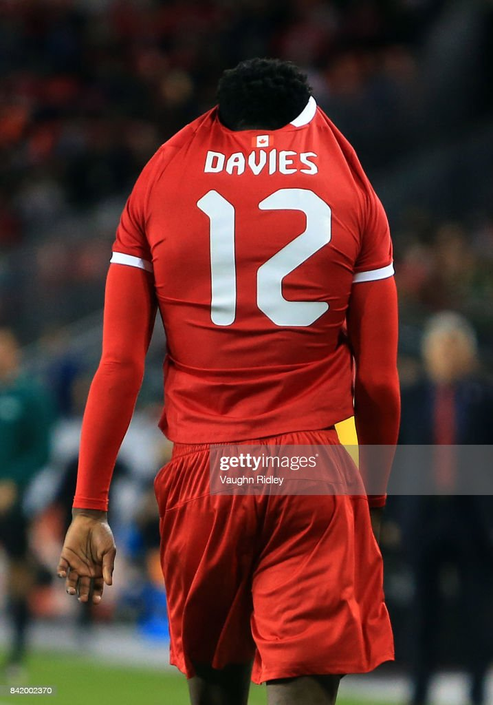 Alphonso Davies #12 of Canada pulls his shirt over his head after being red carded during the second half of an International Friendly match against Jamaica at BMO Field on September 2, 2017 in Toronto, Canada.