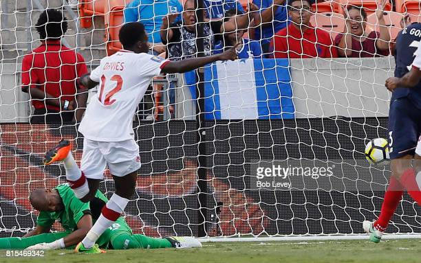 Alphonso Davies of Canada scores as he beats Patrick Pemberton of Costa Rica at BBVA Compass Stadium on July 11, 2017 in Houston, Texas.