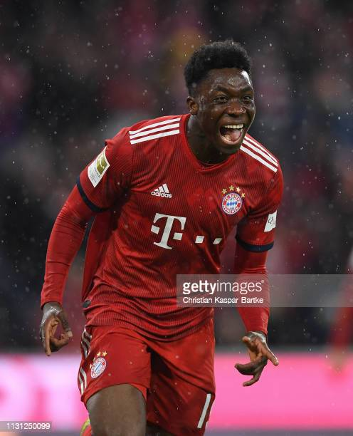 Alphonso Davies of FC Bayern München celebrates after scoring his team`s sixth goal during the Bundesliga match between FC Bayern Muenchen and 1 FSV...