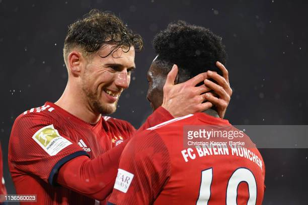 Alphonso Davies of FC Bayern München celebrates after scoring his team`sixth goal with team mate Leon Goretzka of FC Bayern München during the...