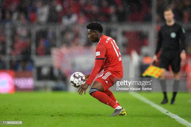 Alphonso Davies of FC Bayern München controls the ball during the Bundesliga match between FC Bayern Muenchen and 1 FSV Mainz 05 at Allianz Arena on...