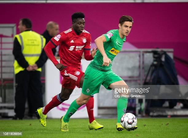 Alphonso Davies of FC Bayern Muenchen and Florian Neuhaus of Borussia Moenchengladbach during the Telekom Cup match between Borussia Moenchengladbach...