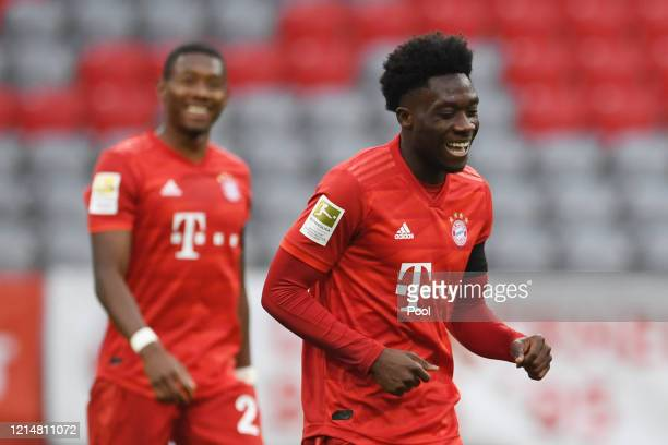 Alphonso Davies of FC Bayern Muenchen celebrates after scoring his team's fourth goal during the Bundesliga match between FC Bayern Muenchen and...