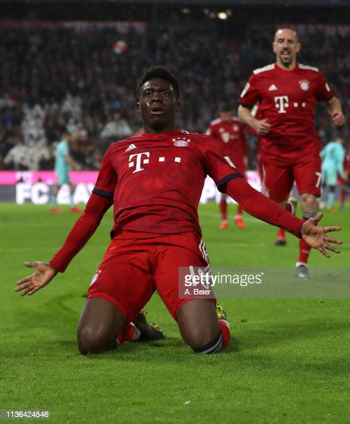 Alphonso Davies of FC Bayern Muenchen celebrates his first goal for Bayern Muenchen with teammate Franck Ribery during the Bundesliga match between...