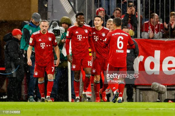 Alphonso Davies of Fc Bayern Muenchen celebrates his team's sixth goal with team mates during the Bundesliga match between FC Bayern Muenchen and 1...