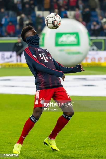 Alphonso Davies of FC Bayern Muenchen controls the ball during the Bundesliga match between TSG 1899 Hoffenheim and FC Bayern Muenchen at...