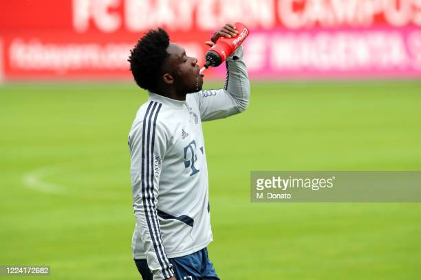 Alphonso Davies of FC Bayern Muenchen drinks during a training session at FC Bayern Campus on May 11 2020 in Munich Germany FC Bayern Muenchen will...