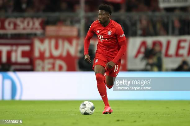 Alphonso Davies of FC Bayern Muenchen in action during the Bundesliga match between FC Bayern Muenchen and RB Leipzig at Allianz Arena on February 9...