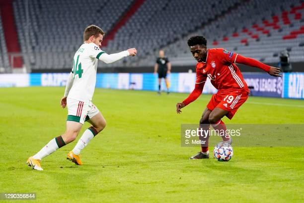 Alphonso Davies of FC Bayern Muenchen is challenged by Dmitri Rybchinsky of Lokomotiv Moskva during the UEFA Champions League Group A stage match...