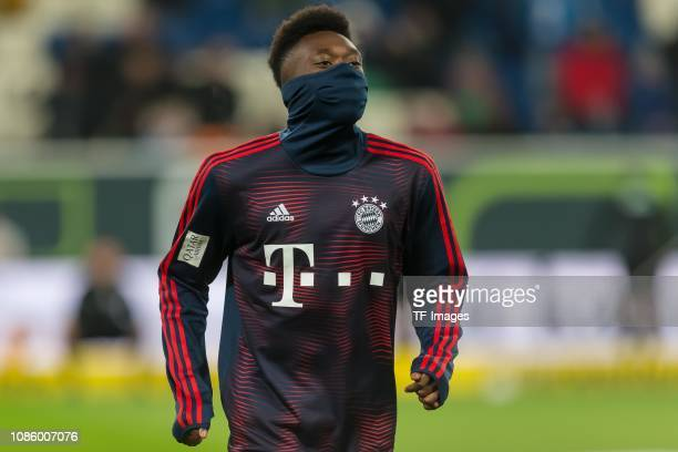 Alphonso Davies of FC Bayern Muenchen looks on during the Bundesliga match between TSG 1899 Hoffenheim and FC Bayern Muenchen at PreZeroArena on...