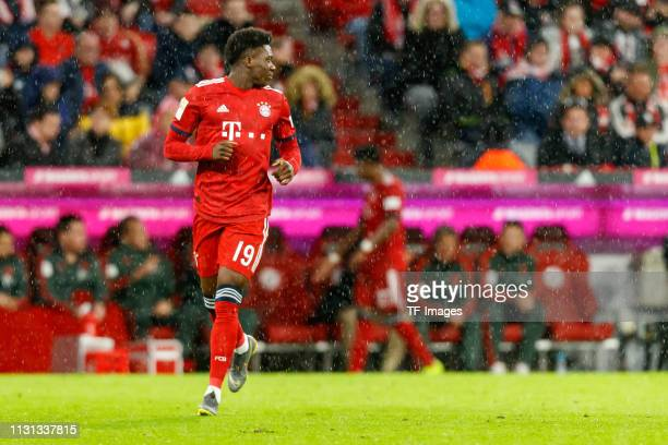 Alphonso Davies of FC Bayern Muenchen looks on during the Bundesliga match between FC Bayern Muenchen and 1 FSV Mainz 05 at Allianz Arena on March 17...