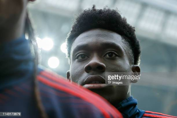 Alphonso Davies of FC Bayern Muenchen looks on prior to the Bundesliga match between RB Leipzig and Bayern Muenchen at Red Bull Arena on May 11 2019...