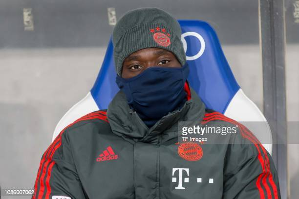 Alphonso Davies of FC Bayern Muenchen on the bench during the Bundesliga match between TSG 1899 Hoffenheim and FC Bayern Muenchen at PreZeroArena on...