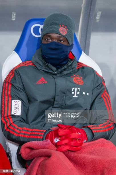 Alphonso Davies of FC Bayern Muenchen on the bench during the Bundesliga match between TSG 1899 Hoffenheim and FC Bayern Muenchen at PreZeroArena on...