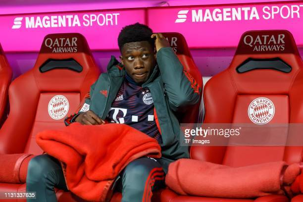 Alphonso Davies of FC Bayern Muenchen on the bench prior to the Bundesliga match between FC Bayern Muenchen and 1 FSV Mainz 05 at Allianz Arena on...