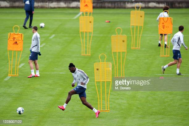 Alphonso Davies of FC Bayern Muenchen plays the ball during a training session at Saebener Strasse training ground on May 05 2020 in Munich Germany