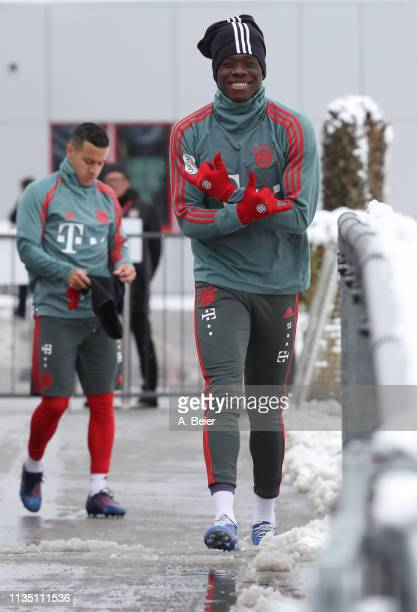 Alphonso Davies of FC Bayern Muenchen poses as he arrives for a training session at the club's Saebener Strasse training ground on March 11 2019 in...