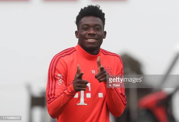 Alphonso Davies of FC Bayern Muenchen poses as he arrives for a training session at the club's Saebener Strasse training ground on August 29 2019 in...