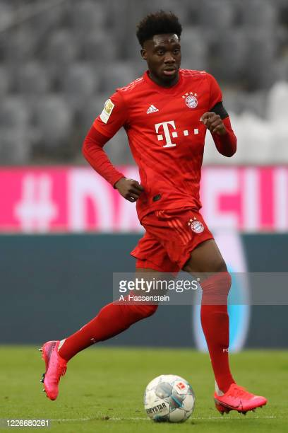 Alphonso Davies of FC Bayern Muenchen runs with the ball during the Bundesliga match between FC Bayern Muenchen and Eintracht Frankfurt at Allianz...