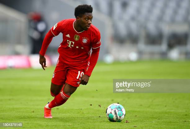 Alphonso Davies of FC Bayern Muenchen runs with the ball during the Bundesliga match between FC Bayern Muenchen and 1. FC Koeln at Allianz Arena on...