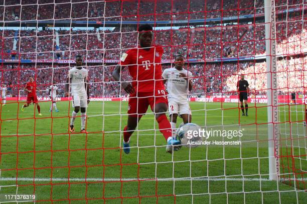 Alphonso Davies of FC Bayern Muenchen scores the 6th goal during the Bundesliga match between FC Bayern Muenchen and 1 FSV Mainz 05 at Allianz Arena...