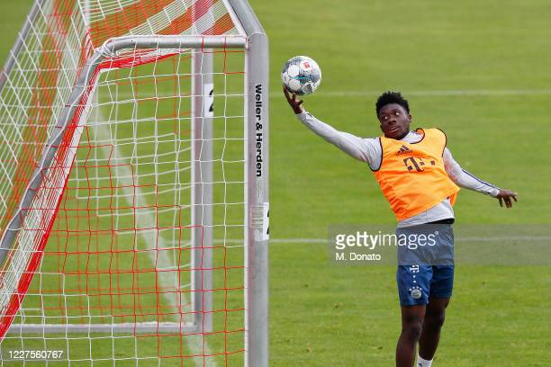 Alphonso Davies of FC Bayern Muenchen tries to catch a ball during a training session at Saebener Strasse training ground on May 28 2020 in Munich...