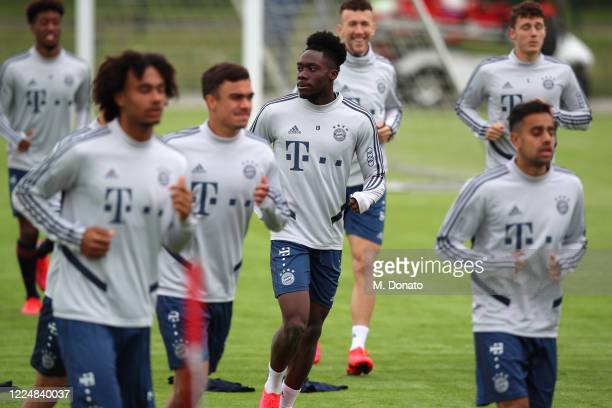 Alphonso Davies of FC Bayern Muenchen warms up during a training session at FC Bayern Campus on May 14 2020 in Munich Germany FC Bayern Muenchen will...