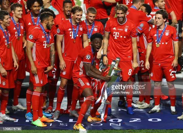 Alphonso Davies of FC Bayern Munich celebrates with the UEFA Champions League Trophy following his team's victory in the UEFA Champions League Final...
