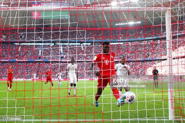Alphonso Davies of FC Bayern Munich scores his team's sixth goal during the Bundesliga match between FC Bayern Muenchen and 1 FSV Mainz 05 at Allianz...
